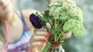 View of bunch of flowers being touched by girl Stock Footage