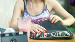 Girl takes stylish, colorful bracelet from her bag Stock Footage