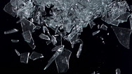 Window pane, glass falling against black background, slow motion Stock Footage