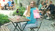 Excited girl showing her shopping bags and new purchase to the camera Stock Footage