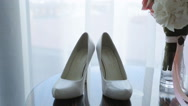 Close up view of bride wedding shoes of white color Stock Footage