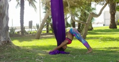 Supple young woman doing stretching exercises Stock Footage