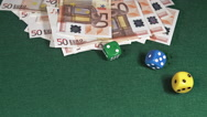 Dice rolling against Green background with 50 euros Bills, slow motion Stock Footage