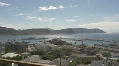 4k Beautiful Blue Water Ocean View Mountains In Background Pier Naval Dockyard Stock Footage