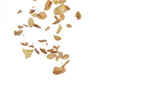 Corn Flakes Falling against White Background, Slow Motion Stock Footage