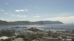 4k Beautiful Blue Water Ocean View Mountains In Background Naval Dockyard Ships Stock Footage