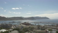 4k Beautiful Blue Water Ocean View Mountains In Background Naval Dockyard Ships Stock Footage