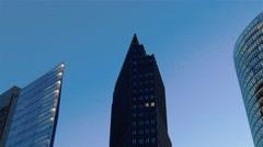 Tilt down medium shot of three Potsdamer platz's skyscrapers in Berlin Stock Footage