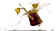 Bottle of Beer falling, Breaking and Splashing on Steel Plate against White Stock Footage