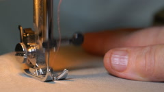 Footage of woman sews on the sewing machine. hd Stock Footage