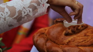 Close up view of bride salting bread due to traditions Stock Footage