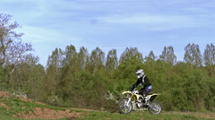 Young Man doing Stunt on Motorbike, Slow Motion and Real Time Stock Footage