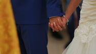 Close up view of couple holding hands having wedding ceremony in church Stock Footage