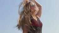 Beautiful girl enjoying the sun and sea Stock Footage