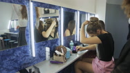 Group of pretty girls sits in front of mirror Stock Footage