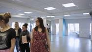 In model school women are preparing for defile Stock Footage