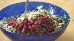 Mixing cranberries into quinoa kale salad Stock Footage