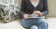 Using a Tablet at Home Stock Footage