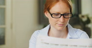 Businesswoman Reading Morning Newspaper Stock Footage