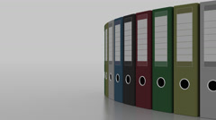 Colored office binders rotation. 4K seamless loopable clip Stock Footage