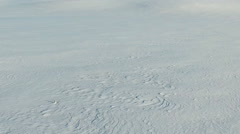 Low flight above snow fields in winter, aerial panoramic view. Stock Footage
