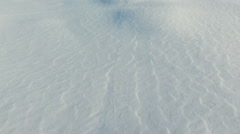 Flight above snow fields in winter, aerial panoramic view. Stock Footage