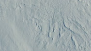 Flight and takeoff above snow fields in winter, aerial top view with rotation. Stock Footage