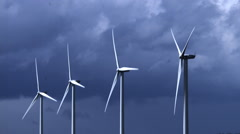 Wind Turbines with Cloudy Sky, near Caen in Normandy, Slow Motion Stock Footage