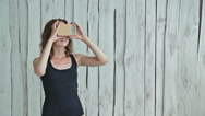 Young curly woman using Virtual Reality Glasses Stock Footage