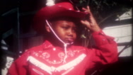 Young black boy dressed as old west cowboy, 3637, vintage film home movie Stock Footage