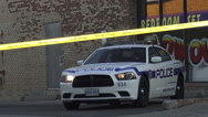 Police car with flashing lights and do not cross yellow tape at a fire in an ind Stock Footage