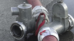 Fire hose extension with fire hose attached Stock Footage
