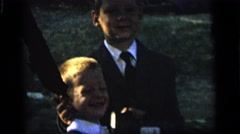 1964: young boys and girl dressed in sunday's best CAMDEN, NEW JERSEY Stock Footage