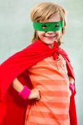 Portrait of smiling boy dressed as superhero in classroom Stock Photos