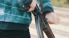 Teenager with a Machine Gun in his Hand Stock Footage