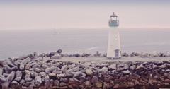 Aerial View Of  harbour and lighthouse at sunset in Santa Cruz, california Stock Footage