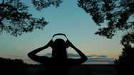 Young women dancing in the forest after sunset Stock Footage