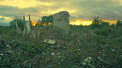 The post-apocalyptic world, The wreckage of the building at sunset Stock Footage
