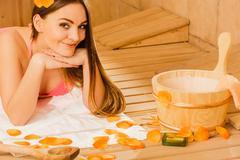 Young woman relaxing in sauna. Spa wellbeing. Stock Photos