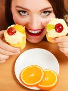 Woman taking delicious sweet cake. Gluttony. Stock Photos