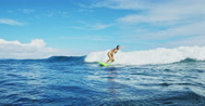 Surfer Girl Riding Wave Stock Footage