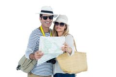 Front view of couple reading map against white background Stock Photos