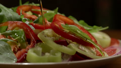 Chef pours oil salad plate Stock Footage