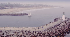 Aerial View Of yatch entering harbour and lighthouse  in Santa Cruz harbor Stock Footage