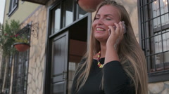 Europe young beautiful girl use a smartphone smiling on a sunny day Stock Footage