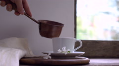 Rustic still life. female hand pours hot water from a copper bucket into the cup Stock Footage