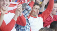 4K Crowd of spectators watching sports game in stadium cheering on their team Stock Footage