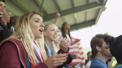 4K Crowd of spectators cheering at sports event with flags of many nations Stock Footage