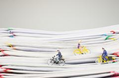 Postmen and woman is cycling on pile overload paperwork Stock Photos