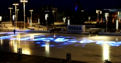 Winter ice rink in Moscow at night, running the light show on the ice Stock Footage